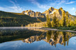 Stanley Lake in the Sawtooth National Forest at sunrise with mountain reflection in water