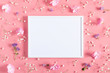 Leinwanddruck Bild - Beautiful flowers composition. Empty photo frame, pink flowers on pastel pink background. Valentines Day, Easter, Birthday, Happy Women's Day, Mother's day. Flat lay, top view, copy space
