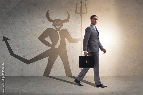 Fotografie, Obraz Devil hiding in the businessman - alter ego concept