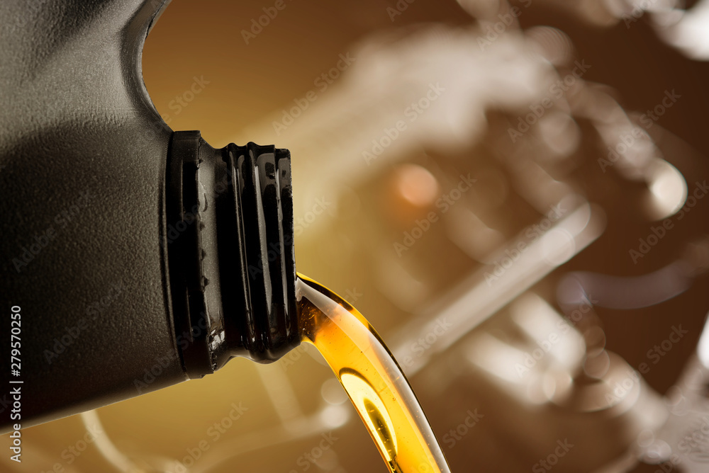 Fototapety, obrazy: Pouring oil lubricant motor car from black bottle on engine background change lube maintenance