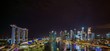 The Central Business District and Marina Bay skyline at dusk in Singapore