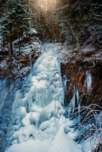 Frozen Waterfall In The Forest