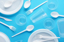 Various White Plastic Disposable Tableware On Blue Background.