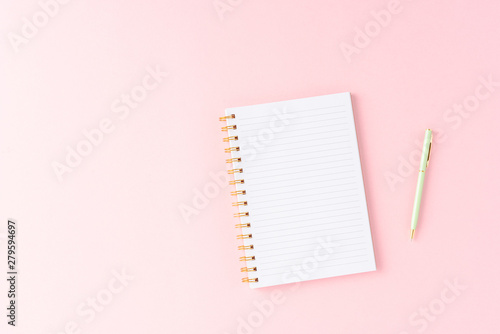 Notebook on pink background. Top view Fototapet
