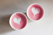 Two Pink Coffee Cups With Hear...