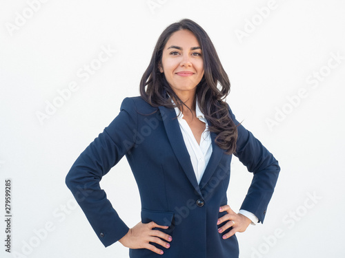 Proud confident business woman posing over white background Poster Mural XXL