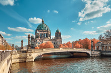 Berlin Cathedral With A Bridge Over Spree River In Autumn