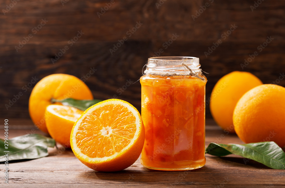 Fototapeta glass jar of orange  jam with fresh fruits