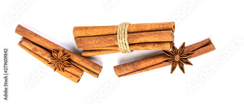 Fototapeta Close up the brown cinnamon stick with star anise spice isolated on white background , overhead and top view obraz