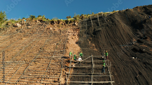 Fotografie, Obraz  Protection of road from mountain slough, rockfall with metal accumulative restraining net fences