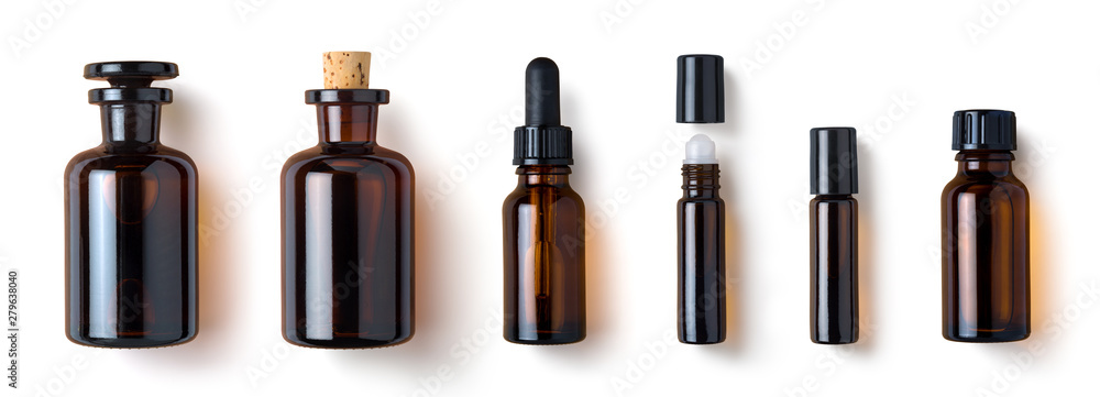 Fototapeta various amber glass bottles for cosmetics, natural medicine , essential oils or other liquids isolated on a white background, top view