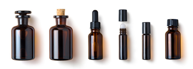 various amber glass bottles for cosmetics, natural medicine , essential oils or other liquids isolated on a white background, top view