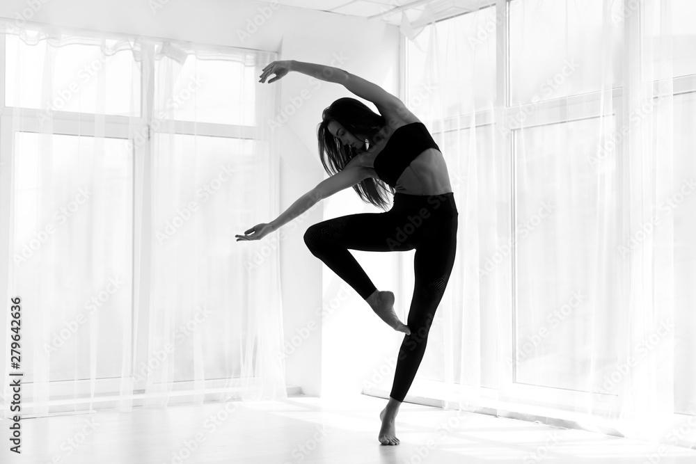 Fototapeta Dancer Training Modern Ballet In Studio. Black And White