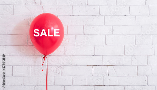 Fotomural  Pink balloon with white text hang out in front of white bricks wall