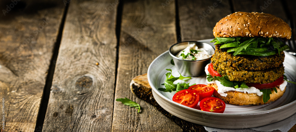 Fototapety, obrazy: Vegan zucchini burger and ingredients on rustic wood background, copy space