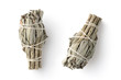 Leinwanddruck Bild - white sage smudge sticks used for spiritual incenses isolated on a white background, two different positions, top view