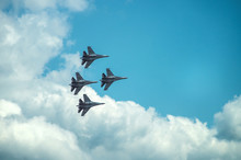 Group Of Four Military Aircraft Of Fighters, Jet Airplane In The Sky Make Maneuvers