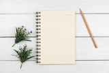 Fototapeta Kawa jest smaczna - Top view of an open notebook with pencil on white wooden desk