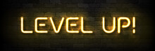 Vector Realistic Isolated Neon Sign Of Level Up Typography Logo For Template Decoration And Covering On The Wall Background. Concept Of Game.