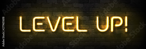 Vector realistic isolated neon sign of Level Up typography logo for template decoration and covering on the wall background Canvas Print