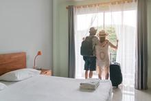 Young Couple Traveler With Lug...