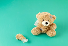 Toy Teddy Bear With Teared Awa...