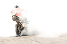 Chopper Motorcycle High Power With A Rider And Person. The Smoke From Under The Wheels, The Rider In The Smoke. Championship Motofristaylu Rear View Of The Athlete Behind The Wheel Of A Motorcycle.