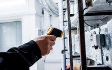 Technician Use Infrared Thermal Imaging Camera To Check Temperature At Fuse-box