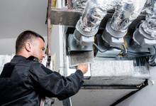 Ventilation Cleaning. Specialist At Work. Repair Ventilation System (HVAC)