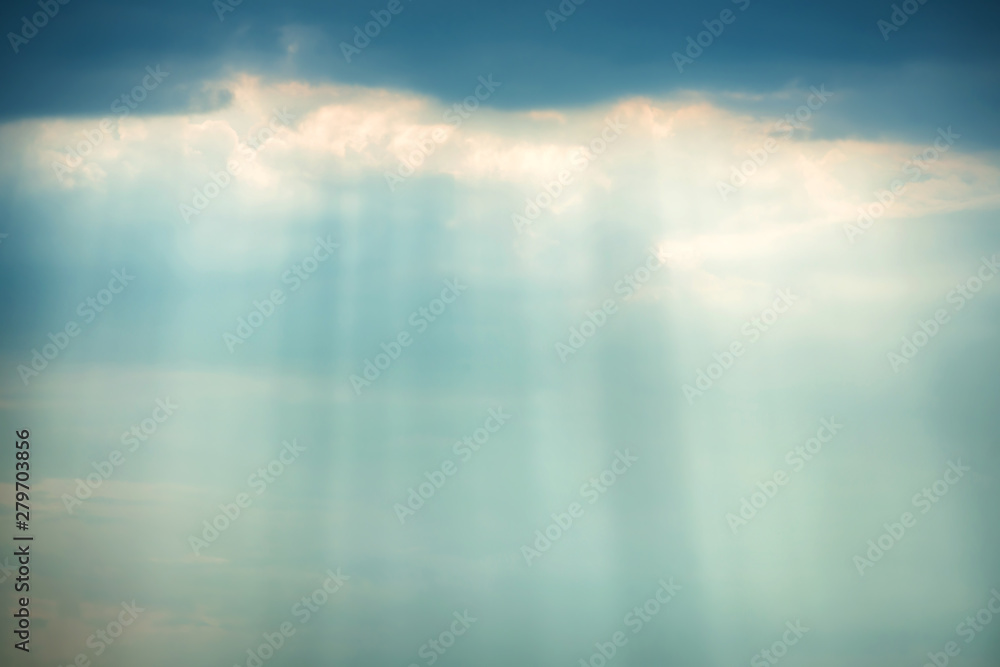 Fototapety, obrazy: Sunset view of dramatic storm sky with dark clouds and bright sunbeams shining through them. Can be used as nature background