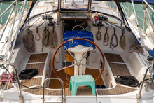 Close-up From Above Of A Boat Interior With The Rudder And Nautical Ropes, Imperia, Liguria, Italy