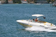 Couple Speeding On The Florida Intra-Coastal Waterway In A Yellow And White Inboard Engine Motorboat