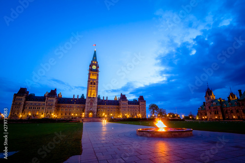 Canada parliament building and centennial flame fountain in Ottawa during blue h Fototapeta