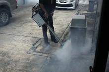 Worker Fogging Residential  An...