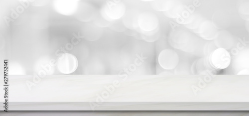 Empty white table top, counter, desk background over blur perspective bokeh light background, White marble stone table, shelf and blurred kitchen restaurant for food, product display mockup, template