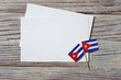 October 10, happy independence Day of Cuba. the concept of patriotism , freedom and independence. Mini flags with a white card on wooden background
