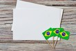 September 7 Brazilian independence Day, the concept of independence , patriotism and freedom. Mini paper flags with white postcards on wooden background. horizontal