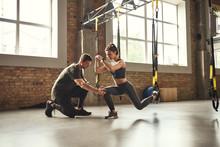 Doing Squat Exercise. Confiden...