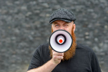 Bearded Man Speaking Into A Me...