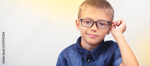 Fotomural Banner little boy with glasses correcting myopia close-up portrait Ophthalmology