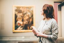 Young Woman Sketching In Museu...