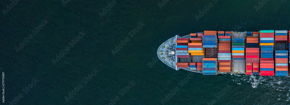 Fototapeta Container ship carrying container for import and export, business logistic and transportation by container ship boat in open sea, Aerial view container ship with copy space for design banner web