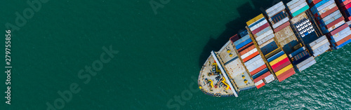 Obraz Container cargo ship carrying container for import and export, business logistic and transportation by container ship boat in open sea, Aerial view container ship with copy space for design banner web - fototapety do salonu