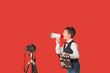 canvas print picture - Little film director on color background