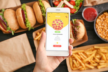 Woman With Mobile Phone Ordering Food Online