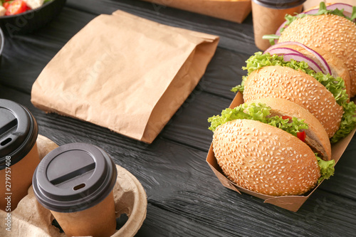 Fototapeta Different tasty food from delivery service on wooden background obraz