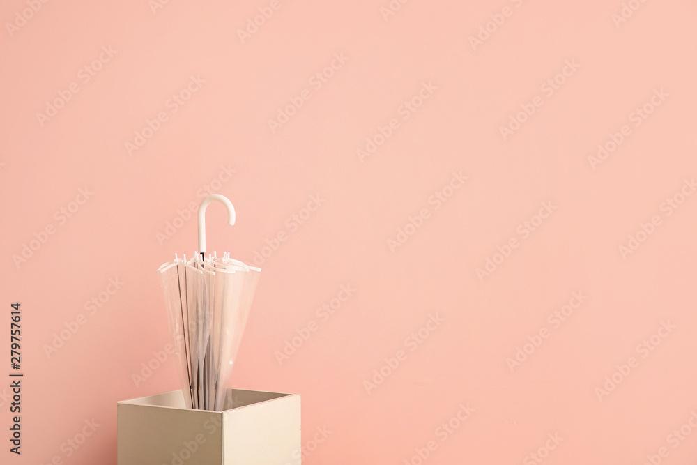 Fototapety, obrazy: Stylish umbrella with box on color background