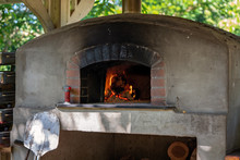 Fire Burning In Old Outdoor Pizza Oven