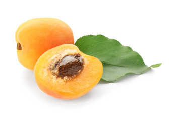 Tasty ripe apricots on white background