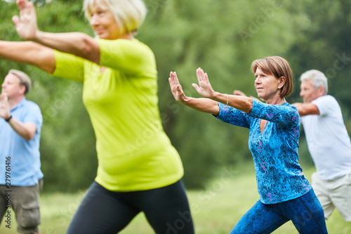 Seniors do Qi Gong or Tai Chi exercise - 279761416